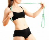 20866909-young-sporty-woman-with-a-measuring-tape-on-a-white-background