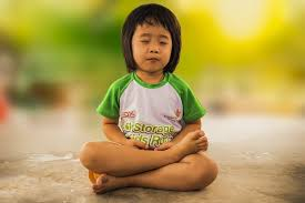 small child meditating
