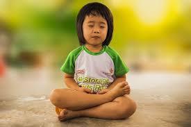 small child meditating